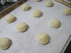 scoop out batter onto a paper lined sheet pan